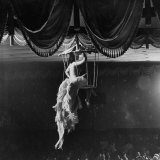 Night Club Dancer Performing a Bird Cage Scene Photographic Print by Yale Joel