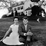 Robert F. Kennedy and Wife Sitting on Lawn at Home Photographic Print by Paul Schutzer