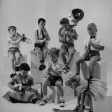 Children Playing Various Musical Instruments Photographic Print by Nina Leen