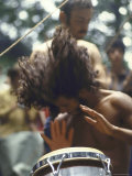 Drummer Playing Instrument with Hands During Woodstock Music Festival Premium Photographic Print by Bill Eppridge