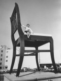 19 Ft. Chair Being Used as an Advertising Stunt Premium Photographic Print by Ed Clark