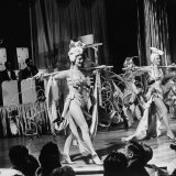 Night Club Dancers Performing a Scene on Stage Photographic Print by Yale Joel