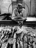 Employee of Fish Stall in the Old City Market Premium Photographic Print by Robert W. Kelley