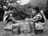 American Child Playing with Chinese Friend, Washing Doll Clothes Fotografisk trykk av John Dominis