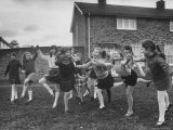 British Children Playing Outdoor Games in London Suburbs Premium Photographic Print by Terence Spencer