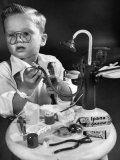 Little Boy with a Toy Dentist Set Fotoprint van Walter Sanders