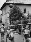 Boys and Girls Playing Volleyball Photographic Print by Lisa Larsen