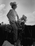 Jean Anne Evans, 14 Month Old Texas Girl, Falling Asleep on Horse with Her Mother Photographic Print by Allan Grant
