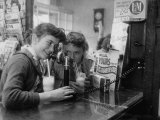 Teenage Girls Drinking Milkshakes at a Local Restaurant Premium Photographic Print by Francis Miller