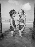 Little Girls Playing Together on a Beach Photographic Print by Lisa Larsen