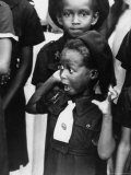 Very Young Jamaican Girl Scout with Surprised Look as She Watches the Arrival of Queen Elizabeth II Premium Photographic Print by Cornell Capa