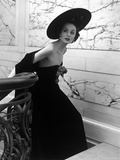 Restaurant Fashions: Cartwheel Hat, Strapless Evening Dress and Stole Photographic Print by Nina Leen