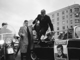 Presidential Candidate John F. Kennedy Leaping from His Car While Campaigning Photographic Print by Paul Schutzer