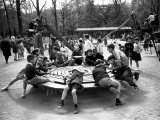 Parisian Children Riding Merry Go Round in a Playground Photographic Print by Alfred Eisenstaedt
