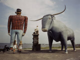 Painted Concrete Sculpture of Paul Bunyon and His Blue Ox, Babe Standing on Shores of Lake Bemidji Premium Photographic Print by Andreas Feininger