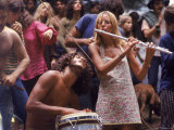 Shirtless Male Drummer and Dress Wearing Female Flutist Jamming During Woodstock Music Festival Premium Photographic Print by Bill Eppridge
