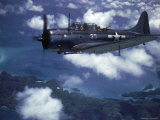 US Navy SBD Dauntless in Flight During Palau Islands Air Raid Attack Photographie par J. R. Eyerman