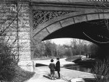 Two Boys Standing under the Ornate Arch of a Bridge in Prospect Park, Brooklyn, Ny Photographic Print by Wallace G. Levison