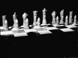 View Showing Chess Pieces with Faces Carved Into Them Photographic Print by David Scherman