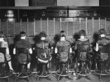 View of Row of Operators from Behind at Busy Switchboard at Telephone Company Photographic Print by Louis R. Bostwick
