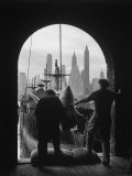 Men Unloading Coffee at Brooklyn Dock. View of Downtown Manhattan in Background Photographic Print by Andreas Feininger