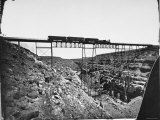 Train Traveling over Santa Fe Railroad Bridge, Which is Built over Canyon Diablo Premium Photographic Print