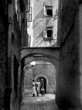 Three Young Women Chatting in Cobbled Alleyway of Old Section of Salzburg Premium Photographic Print by Alfred Eisenstaedt