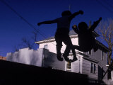 Silhouette of Children Bouncing on a Trampoline Premium Photographic Print by Bill Eppridge