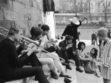Young Parisian Musicians Enjoying an Impromptu Outdoor Concert on the Banks of the Seine River Premium Photographic Print by Alfred Eisenstaedt