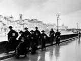 Monks Walking Along the River Arno Premium Photographic Print by Alfred Eisenstaedt