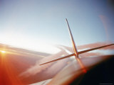 Vapor Trails Streaming from Tail of Jet in Flight Photographic Print by Howard Sochurek