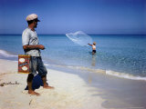 Man Watching Fisherman with a Net Working Along Varadero Beach Premium Photographic Print by Eliot Elisofon