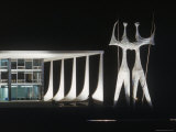 Sculptures in Front of Oscar Niemeyer Designed Building Lit Up at Night Photographic Print by Dmitri Kessel