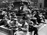Woman Knitting Among Lunchtime Loungers Relaxing at Base of Statue at New York Public Library Premium Photographic Print by Alfred Eisenstaedt
