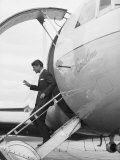 Robert Kennedy Exiting His Campaign Jet During His Campaign Premium Photographic Print by Bill Eppridge