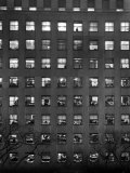 The Pattern of Lighted Office Windows in the RFC Building Premium Photographic Print by Walter B. Lane