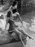 Pair of Models Showing Off New Bathing Suits on the Banks of the River Premium Photographic Print by Nina Leen