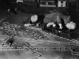 Two Men Lying on the Floor, Constructing a Railroad, at Toy Train Society Photographic Print by Alfred Eisenstaedt