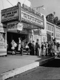 The Movie Theater Boosting Business by Caring For Child Customers on the Weekends Premium Photographic Print by Allan Grant