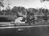 President Franklin D. Roosevelt Driving in His Convertible with His Dog Fala Through Hyde Park Photographic Print by George Skadding