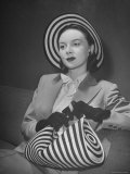 Model Michele Fallon Wearing John Frederics Striped Straw Hat with Matching Handbag Photographic Print by Nina Leen
