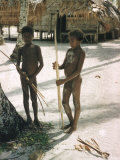Two Naked Native Male Children with Bows and Arrows Standing on White Beach, Santa Cruz Island Premium Photographic Print by Eliot Elisofon