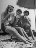 Peter Coe with Martha O'Driscoll Eating Abalone Sandwiches Premium Photographic Print by John Florea