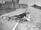 View of a Couple Lying on a Brick Road Premium-Fotodruck von Hans Wild