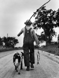 Young Boy and His Dog Walking Home from Fishing Photographic Print by Myron Davis