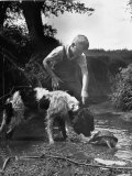 Young Farm Boy Watching His Dog Sniff a Large Turtle at the Pond Photographic Print by Myron Davis