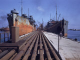 Pipeline Running to Loading Pier at Oil Refinery Photographic Print by Dmitri Kessel