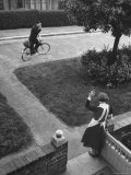 Robert Neve Waving to His Wife While Riding Away on Bicycle Premium-Fotodruck von Hans Wild