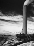 View of a Smoke Stack and Reclamation Buildings at the Very Top of the Hill Premium Photographic Print by Charles E. Steinheimer