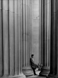 Student Leaning Against Ionic Columns at Entrance of Main Building at MIT Premium Photographic Print by Gjon Mili